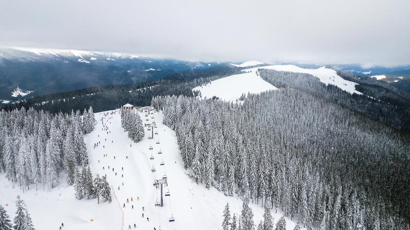 Aerial view of the cable car in the ski resort royalty free stock photo