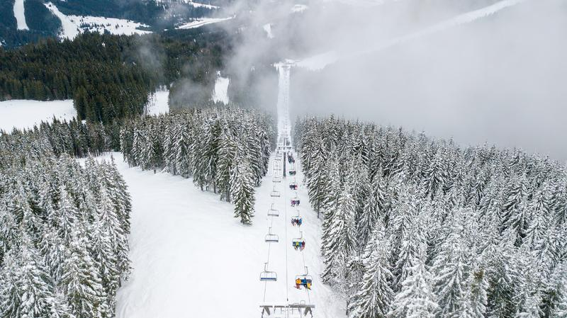 Aerial view of the cable car in the ski resort royalty free stock photos