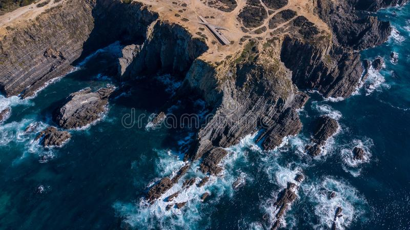Aerial view of the Cabo Sardao cliffs and Waves Atlantic coast Portugal royalty free stock image
