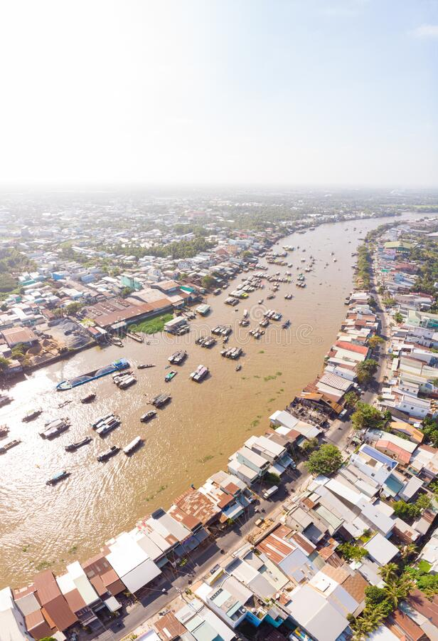 Aerial view of Cai Rang floating market at sunrise, boats selling wholesale fruits and goods on Can Tho River, Mekong Delta region stock photos