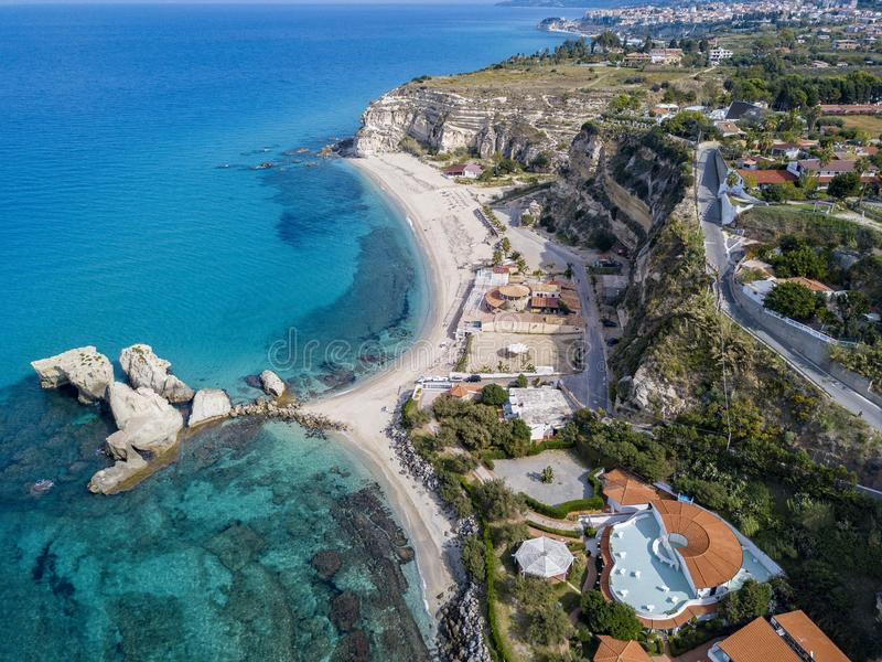 Aerial view of the Calabrian coast, villas and resorts on the cliff. Transparent sea and wild coast. Riaci rocks royalty free stock photos