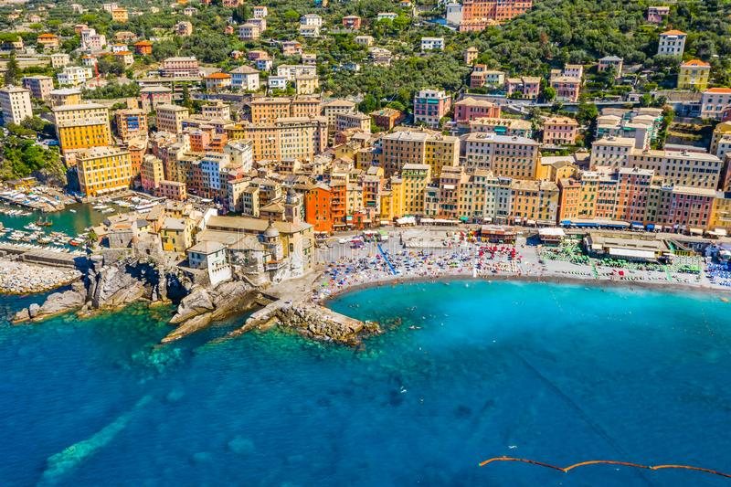 Aerial view of Camogli. Colorful buildings near the ligurian sea. View from above on the public beach with azure and clean water royalty free stock photo