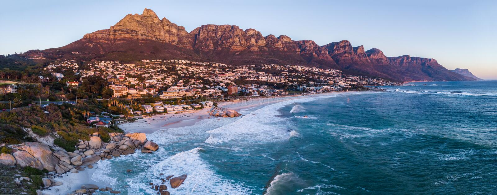 Aerial view on Camps Bay while sunset royalty free stock photos