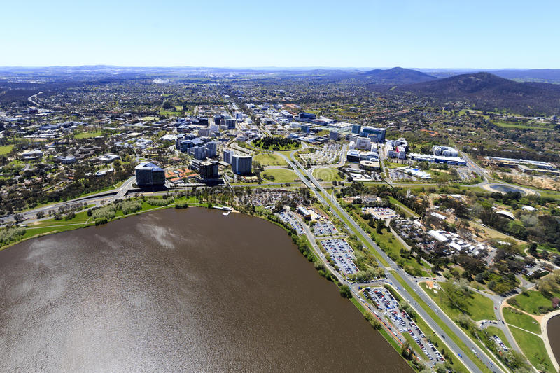 Aerial view of Canberra City. An aerial view from a helicopter above Lake Burley Griffin in Canberra. Looking north towards the city or Civic as it is known stock photography