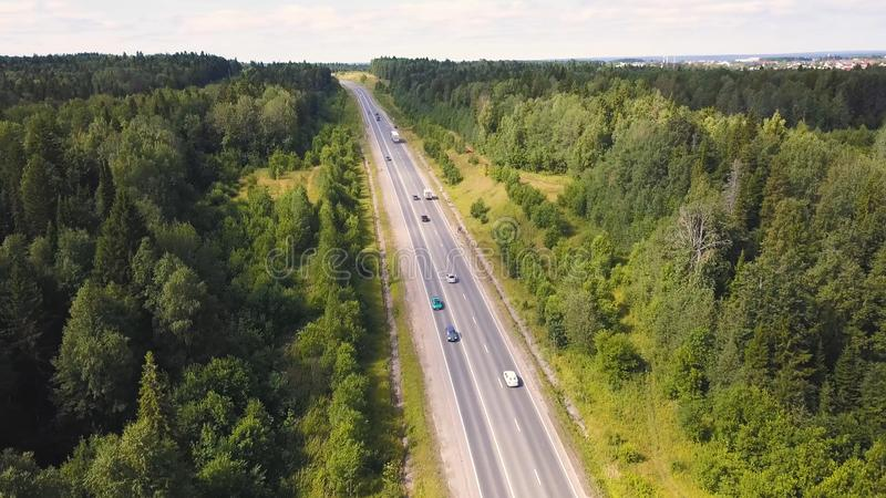 Aerial view of car driving through the forest on country road. Cip. Cars Driving Through Forest Road Drone Travel. Aerial view of car driving through the forest royalty free stock photos