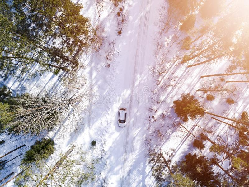 Aerial view of a car on winter road. Winter landscape countryside. Aerial photography of snowy forest with a car on the road. Capt. Ured from above with a drone royalty free stock photos