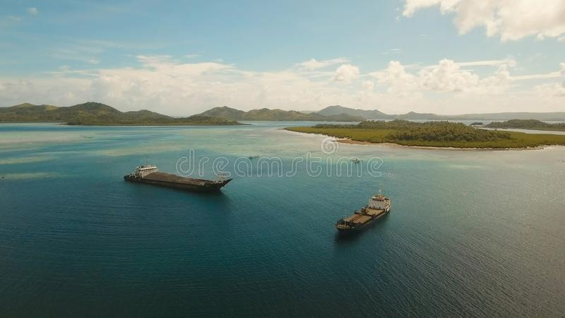 Aerial Cargo and passenger ships in the sea. Philippines, Siargao. stock photo