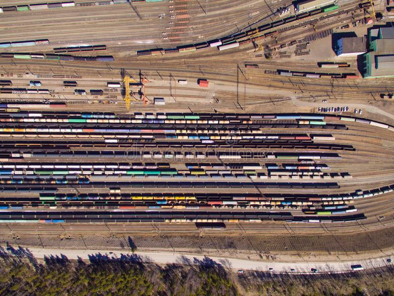 Aerial view of cargo trains. Railway wagons with goods on railroad. Top view of colorful freight train on the railway station stock images