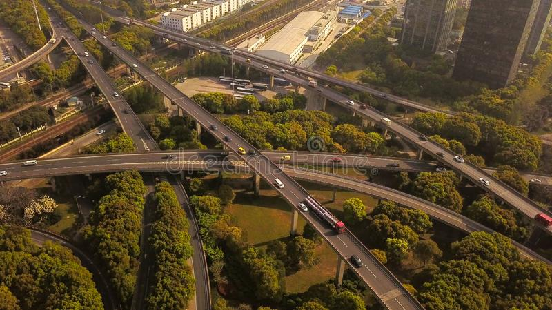 Aerial view of cars on highway junctions. Bridge roads or streets in structure of architecture and transportation concept. Top. View. Urban city, Shanghai at royalty free stock photography