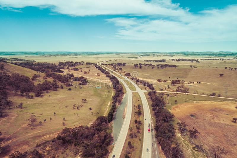 View of cars and trucks driving on Hume Highway. royalty free stock photos
