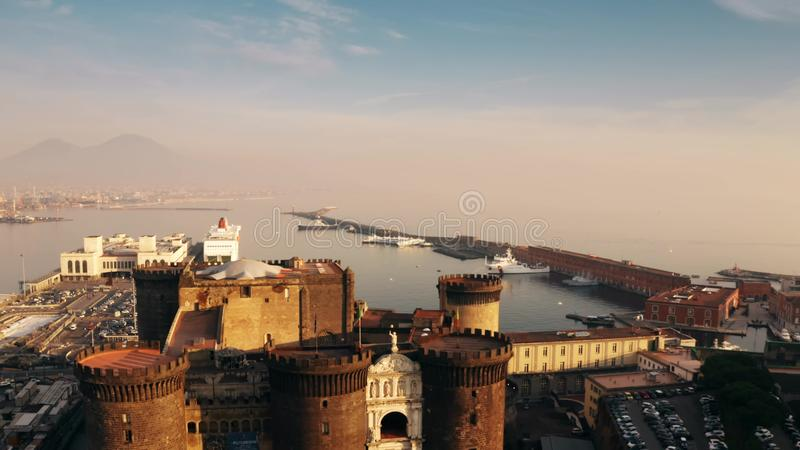 Aerial view of Castel Nuovo castle, Mount Vesuvius and sea. Naples, Italy royalty free stock images