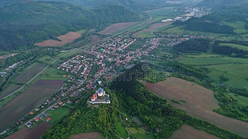 Aerial view of castle Slovenska Lupca and village of the same name under it during cloudy spring day. Banska Bystrica region. Central Slovakia royalty free stock images