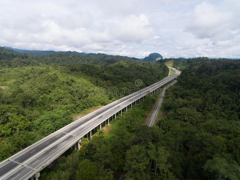 Aerial view of Central Spine Road CSR highway located in kuala lipis, pahang, malaysia. Is a new highway under construction in the center of Peninsula Malaysia stock images
