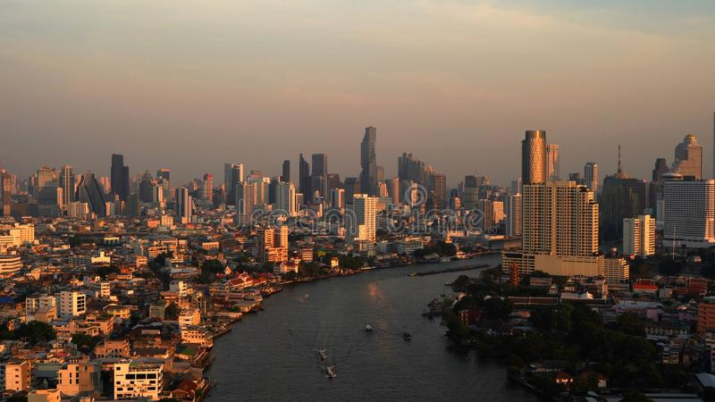 Aerial view of Chao Phraya River, Bangkok Downtown. Thailand. Financial district and business centers in smart urban city in Asia royalty free stock image