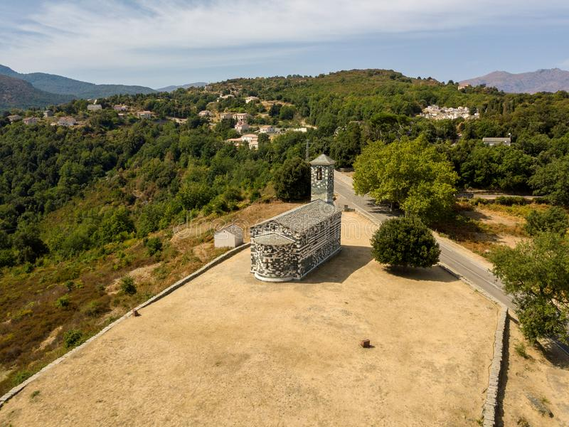 Aerial view of the church of San Michele de Murato, bell tower and apse. Corsica, France royalty free stock images