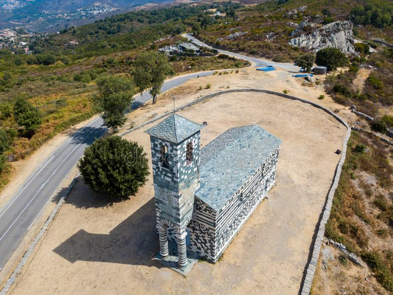Aerial view of the church of San Michele de Murato, bell tower and apse. Corsica, France royalty free stock photos