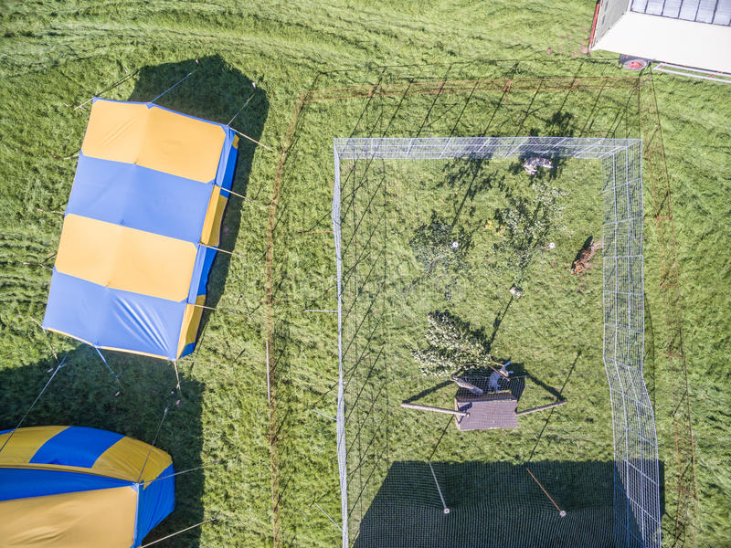Aerial view of a circus tent and white tigers. Aerial view of a circus tent with cage of white tigers stock photo
