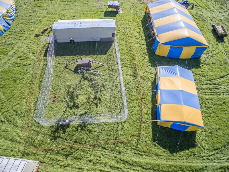 Aerial view of a circus tent and white tigers. Aerial view of a circus tent with cage of white tigers stock images