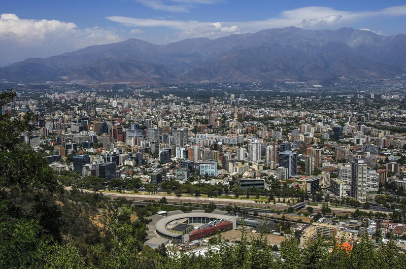 Aerial view of a city and The Andes mountain in the background, Santiago, Chile stock photos