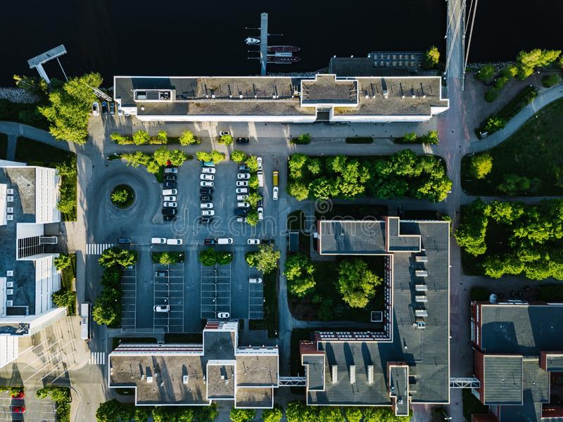 Aerial view of city buildings with car parking. University of Jyvaskyla in Finland. Aerial view of city buildings with car parking and lakeside. University of stock photos