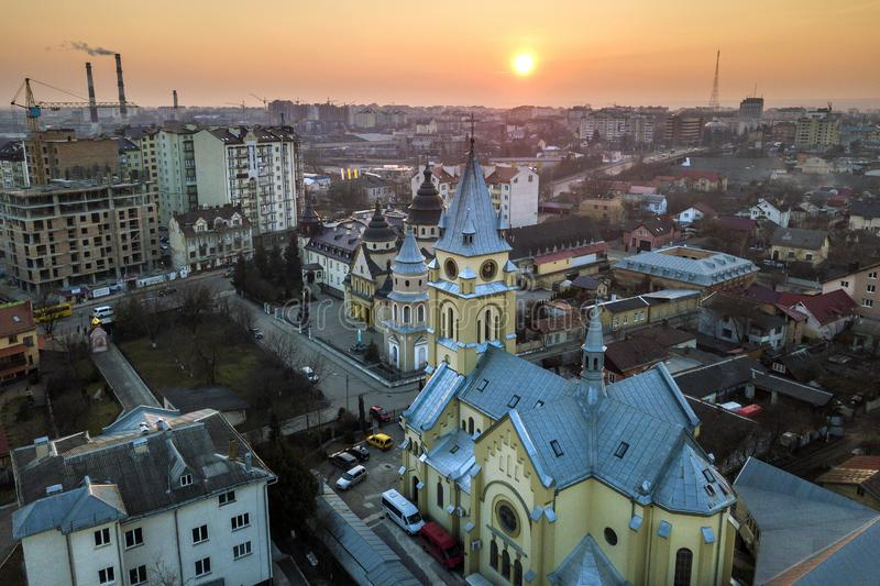 Aerial view of city at dawn or dusk. Urban landscape with church domes, parked cars, high buildings on bright pink sky at sunset royalty free stock photos