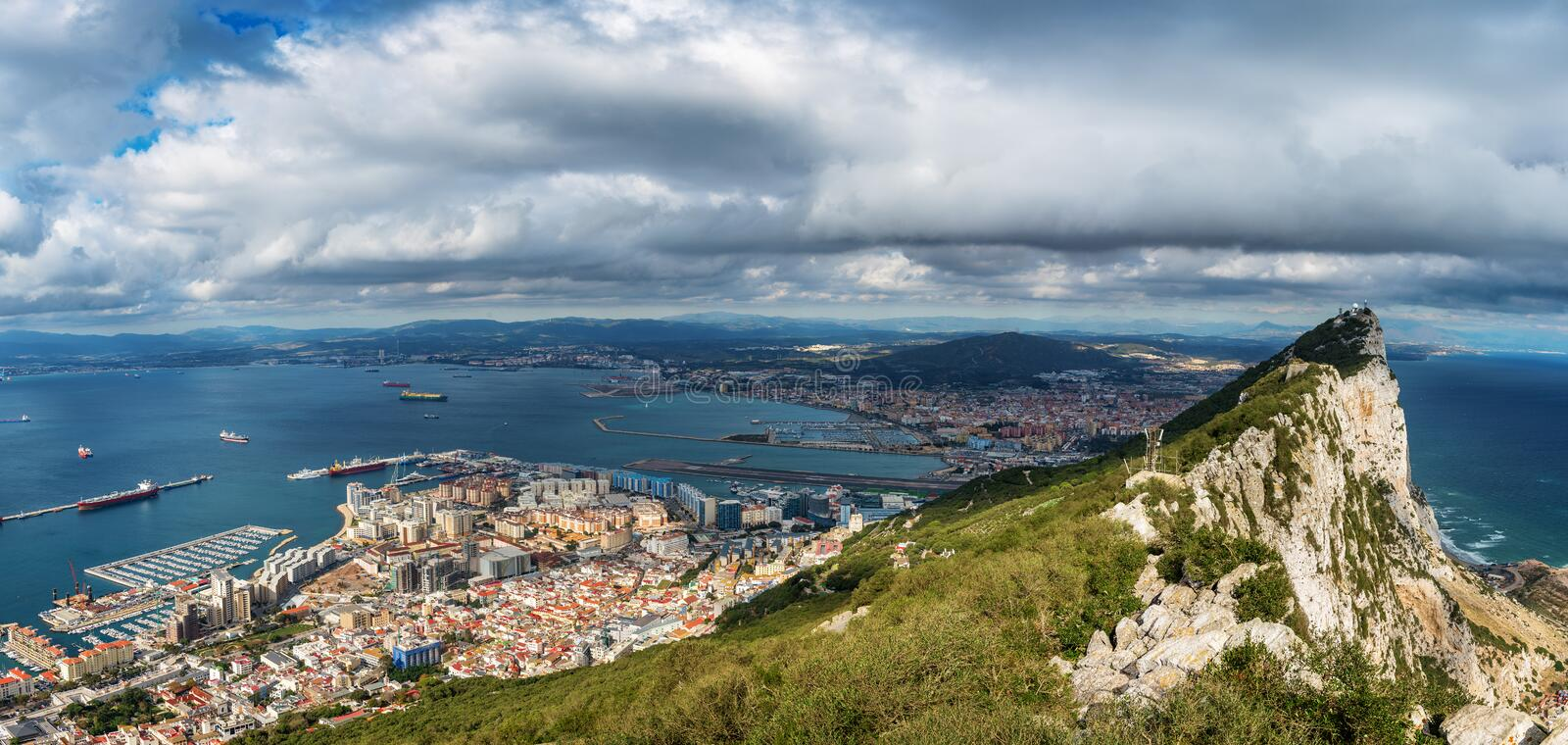 Aerial view on city of Gibraltar from Upper Rock Natural Reserve: on the left Gibraltar town and bay, La Linea town in Spain royalty free stock photo