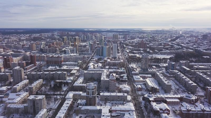 Aerial view of the city and many houses, roads, and yards in the winter time. Clip. Beautiful cityscape with different. Aerial view of the city and many houses royalty free stock photo