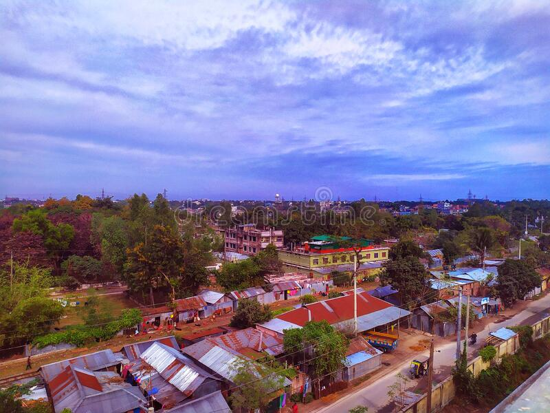 Aerial view of the city of Rangpur. Panorama of a town. Landscape scene in Bangladesh.Urban environment landscape with many green. Trees. Architectural view of stock photos