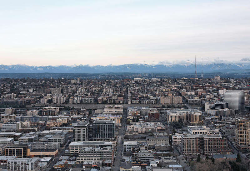 Aerial view of City skyline and mountains stock images
