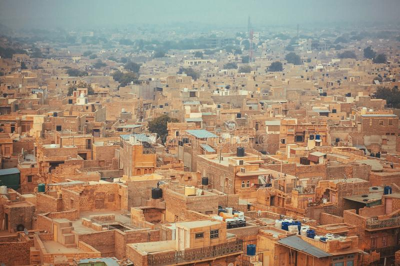 Aerial view on city streets and stone houses at evening fog. Jaisalmer lies in the heart of the Thar Desert of India stock photos