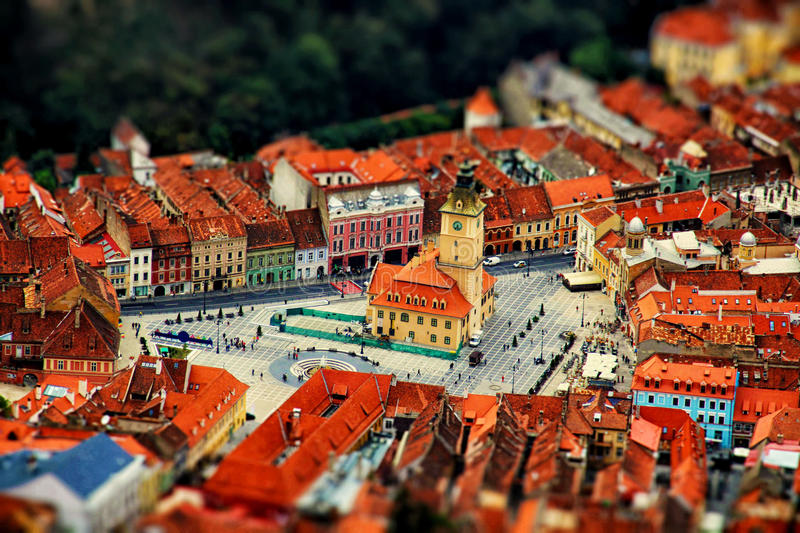 Aerial view of city with tilt-shift effect. Romania. Brasov royalty free stock photos