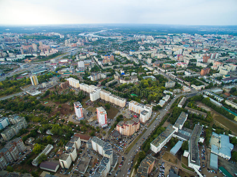 Aerial view of city Ufa from traffic, buildings, river, forest. Aerial view of the city Ufa from the river, the village, park, plant. Russia royalty free stock image