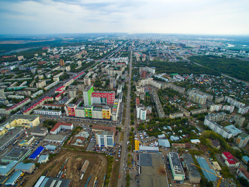 Aerial view of city Ufa from traffic, buildings, river, forest. Aerial view of the city Ufa from the river, the village, park, plant. Russia royalty free stock images