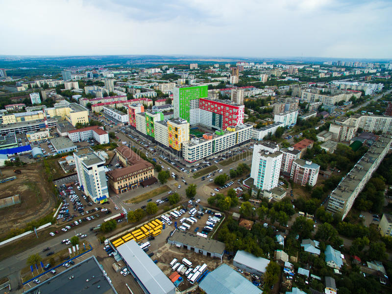 Aerial view of city Ufa from traffic, buildings, river, forest. Aerial view of the city Ufa from the river, the village, park, plant. Russia stock photo