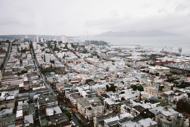Aerial View of City Under Cloudy Sky royalty free stock images