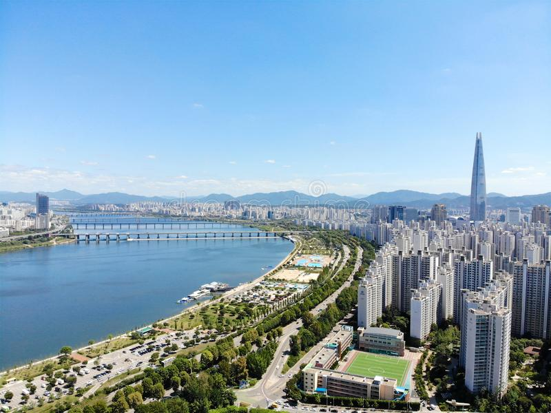 Aerial view cityscape of Seoul, South Korea. Aerial View Lotte tower at Jamsil. View of Seoul with river and mountain. Seoul downtown city skyline, Aerial view royalty free stock photo