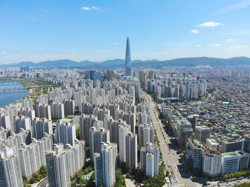 Aerial view cityscape of Seoul, South Korea. Aerial View Lotte tower at Jamsil. View of Seoul with river and mountain. Seoul downtown city skyline, Aerial view royalty free stock image