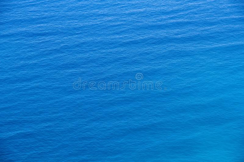 Aerial view of the sea surface. Aerial view of the clear blue sea surface on a bright sunny day stock image
