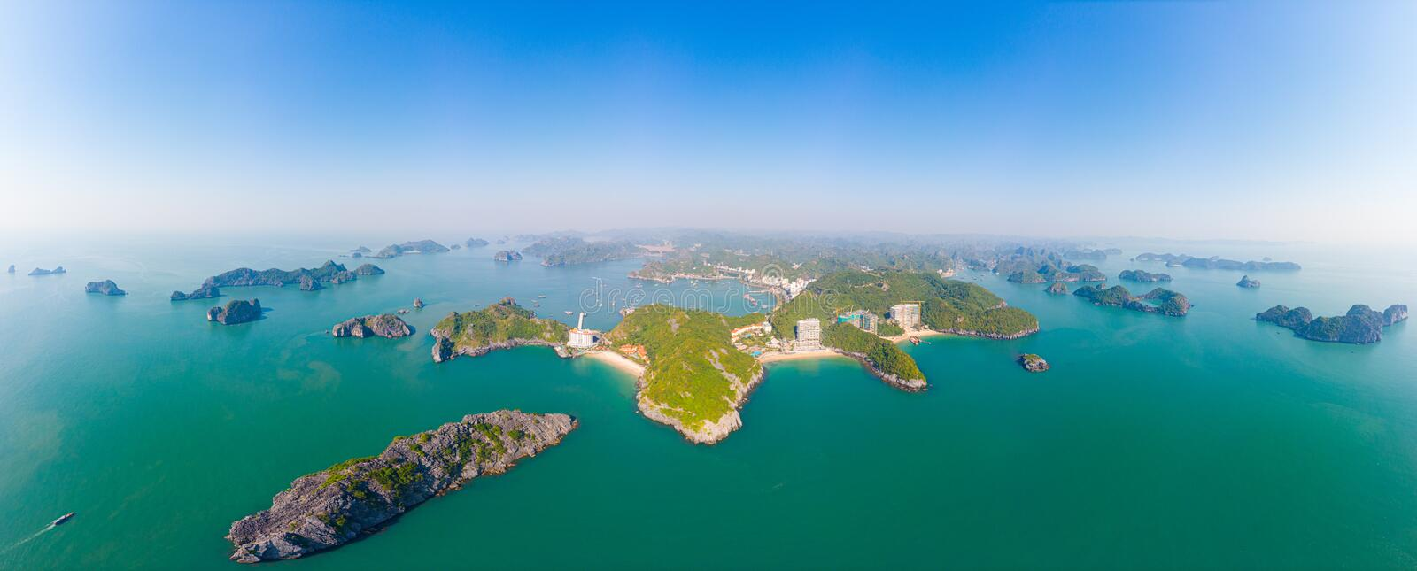 Aerial view: clear blue sky at Cat Ba island and beach, the biggest island in Ha Long Bay, unique limestone rock islands and karst royalty free stock images