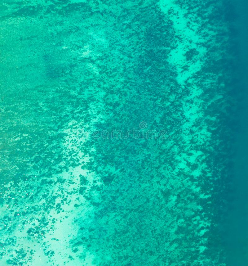 Aerial view of clear blue turquoise seawater, Andaman sea in Phuket island in summer season, Thailand. Water in ocean material stock image