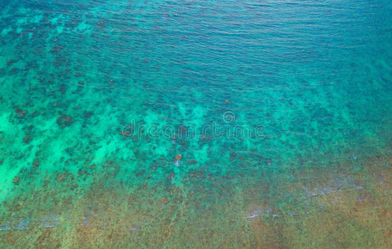 Aerial view of clear blue turquoise seawater, Andaman sea in Phuket island in summer season, Thailand. Water in ocean material royalty free stock photos