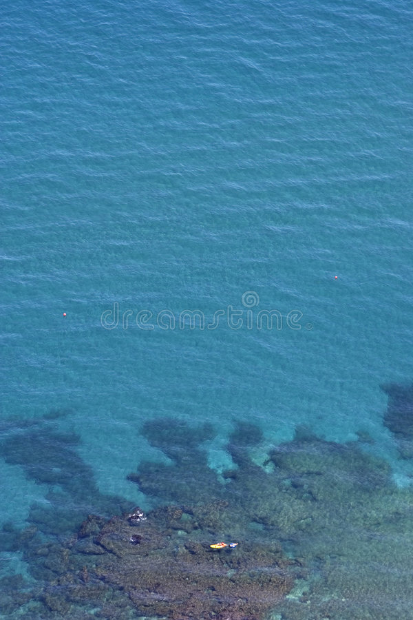 Aerial view of clear blue water and yellow boat stock image