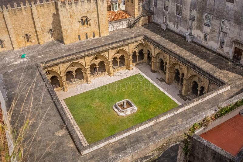 Aerial view at a cloister on classic building Cathedral of the Sé Velha ; in Coimbra, Portugal. Coimbra / Portugal - 04 04 2019 : Aerial view at a cloister on stock photos