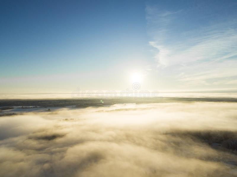 Aerial view clouds over forest during winter colors. Aerial view of forest and clouds. Coastline. Aerial drone view of the forestA. Aerial view clouds over stock photo