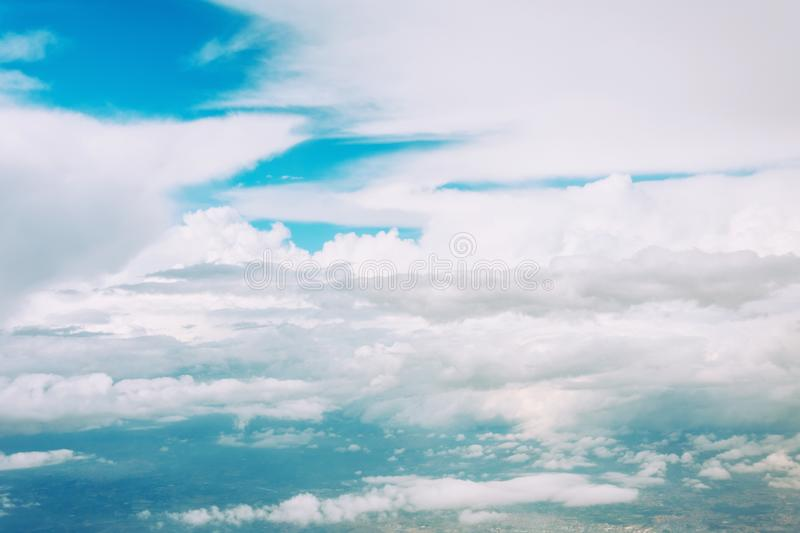 Aerial view cloudscape from the plane of fluffy rain cloud in daytime stock images