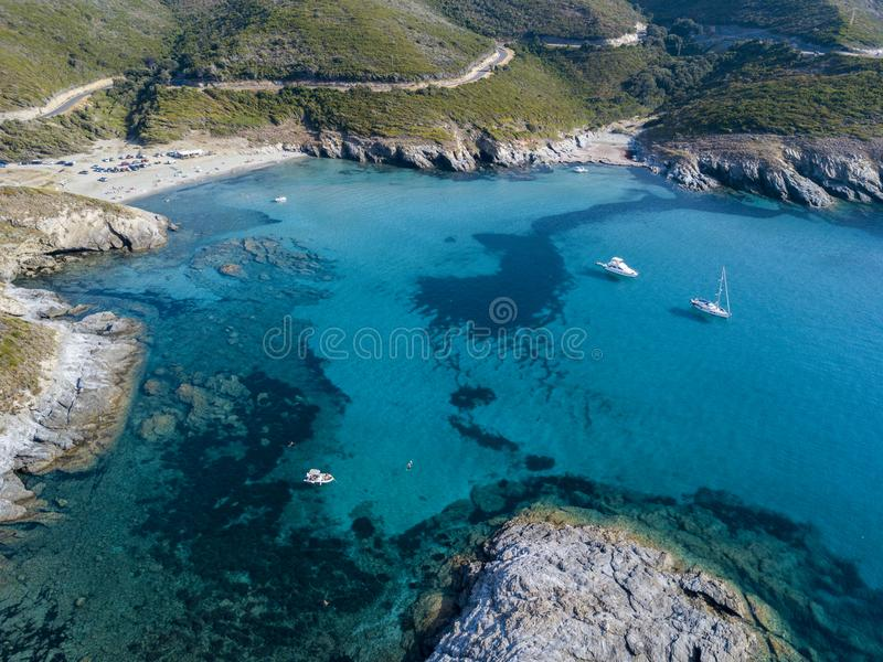 Aerial view of the coast of Corsica, winding roads and coves with crystalline sea. Gulf of Aliso. France. Aerial view of the coast of Corsica, winding roads and royalty free stock photo