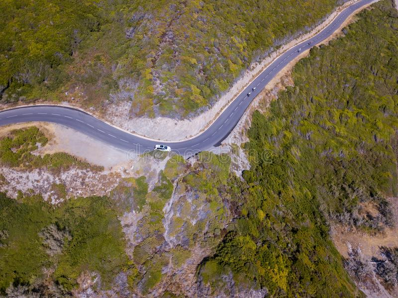 Aerial view of the coast of Corsica, winding roads. Cyclists running on a road. France stock photography