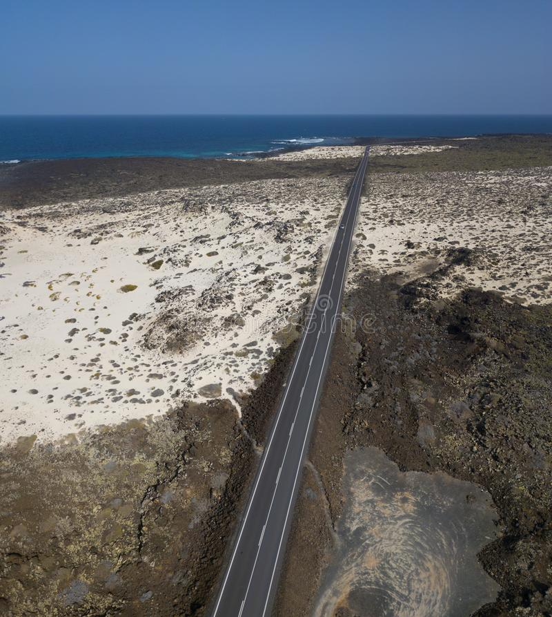 Aerial view of the coastal road that crosses the beaches and coves of Mojón Blanco and Spiral Caleta. Lanzarote, Canary Islands, stock photos
