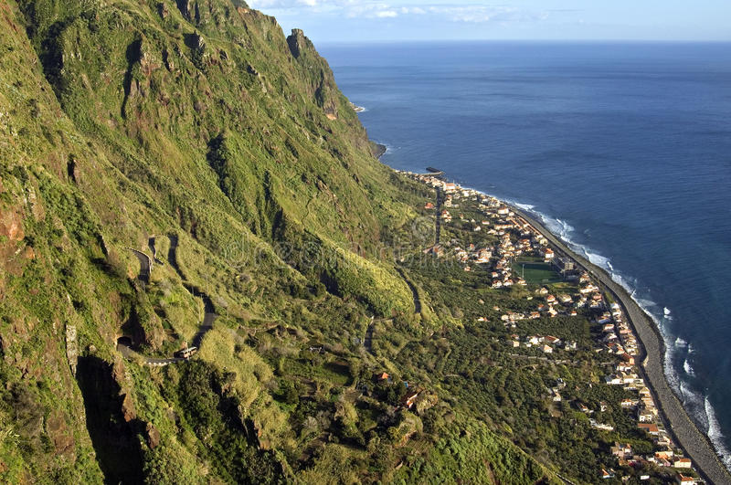 Aerial view of coastal village, cliffs, Atlantic Ocean. Portugal, Madeira Island, village Paul do Mar. This traditional fishing village lies in a deep valley stock photo