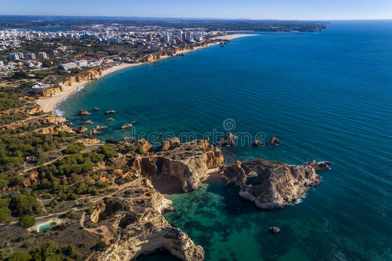 Aerial view of the coastline with beautiful beaches along the city of Portimao in Algarve royalty free stock images